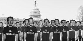 Lauter Pappaufsteller mit Mark Zuckerbergs Bild stehen vor dem Capitol Hill in Washington.