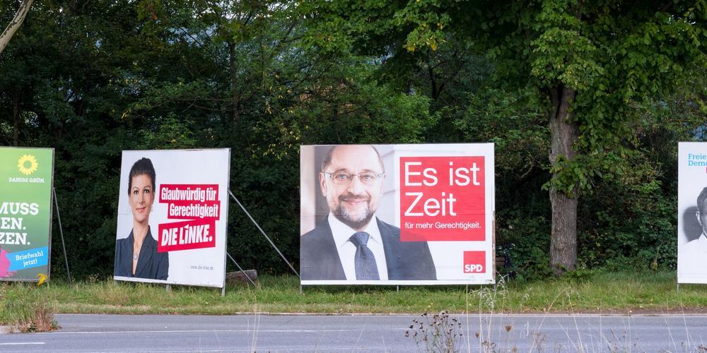 Wahlplakate von Linke und SPD.