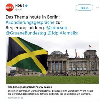 Tweet von NDR2 zu den Sondierungsgesprächen mit einem Bild des Reichstagsgebäudes, vor dem eine Jamaika-Flagge weht.