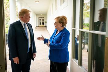 Donald Trump und Angela Merkel.