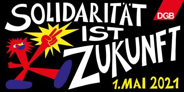 """Graffiti mit dem Text """"Solidarität ist Zukunft"""" auf schwarzem Grund. Links regt eine Zeichentrickfigur in rot zwei Finger zum Victoryzeichen."""