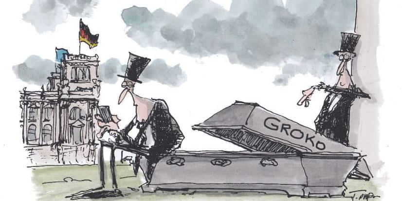 Karikatur von zwei Totengräbern in dunkler Kleidung und einem geöffneten Sarg, auf dem Groko steht.