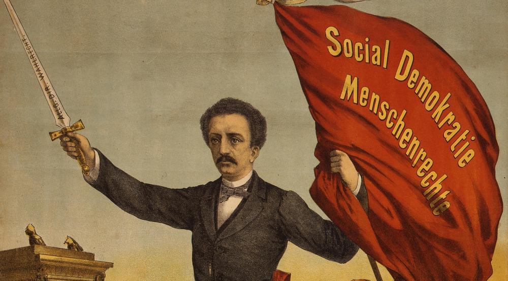 Gemälde von Ferdinand Lassalle aus dem Jahr 1870 mit einer Fahne, auf der steht: Social, Demokratie, Menschenrechte