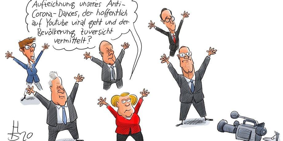 Karikatur von Politikern in Hampelmann-Pose vor einer Kamera, im Vordergrund Angela Merkel, daneben und dahinter Mitglieder des Kabinetts.