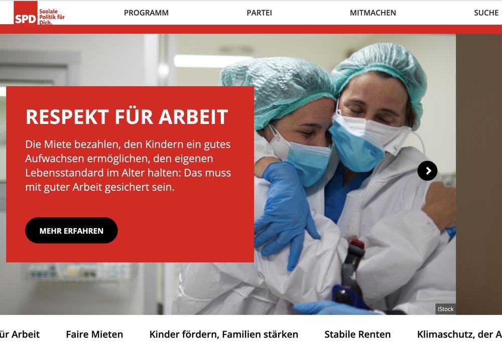"""Ausschnitt der SPD-Internetseite mit rot unterlegtem Text """"Respekt für Arbeit"""" und Bild von zwei Krankenschwestern, die sich umarmen."""